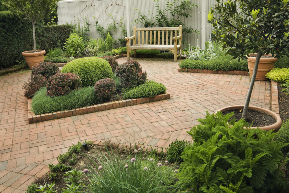 Look at the attention to detail on this beautifully landscaped brick patio area.