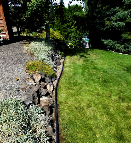 This Spring Clean up where garage and rock wall flow to the lawn below, located in Spokane WA.