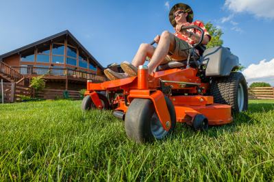 Bradley Lawn Care professional doing a great job mowing a lawn in Spokane WA.